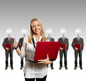 Woman and lamp head businesspeople with laptop — Stock Photo