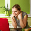 Stock Photo: Tender pregnant female with laptop