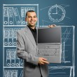 Businessman with open laptop in his hands — Stock Photo