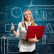 Female with laptop shows well done — Stock Photo #5801336