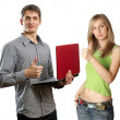 Man with laptop in his hands and woman — Stock Photo #5801390