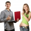 Man with laptop in his hands and woman - Stock Photo