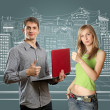 Man with laptop in his hands and woman — Stock Photo
