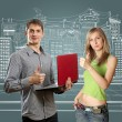 Man with laptop in his hands and woman — Stock Photo #5801397