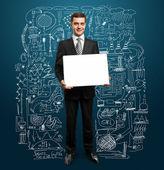 Businessman with empty write board — 图库照片
