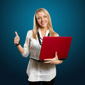 Female with laptop shows well done — Stock Photo