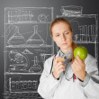 Scientist woman with apple — Stock Photo #5851378