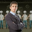 Stock Photo: Lamp head businesspeople shows well done