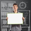 Male with write board in his hands — Stock Photo