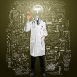 Stock Photo: Lamp-head doctor male writing something