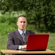 Man with laptop working outdoors — Stock Photo #6184834