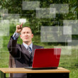 Man with laptop working outdoors — Stock Photo