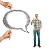 Human hands with speech bubble and man — Stockfoto