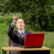 Man with laptop working outdoors — Foto de Stock