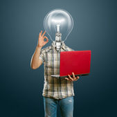 Casual lamp-head with laptop shows OK — Stock Photo