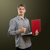 Male with laptop in his hands well done — Stock Photo