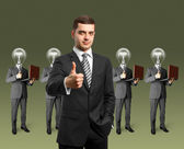 Lamp head business with laptops — Stock Photo