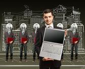 灯头商人用的笔记本电脑 — 图库照片