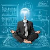 Lamp-head businessman in lotus pose — Stock Photo
