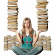Woman in lotus pose with many books in her hands — Stock Photo