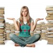 Woman in lotus pose with many books near — Stock Photo #6406865