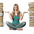 Woman in lotus pose with many books near — 图库照片