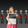 Woman and lamp head businesspeople with laptop — Stock Photo #6459480