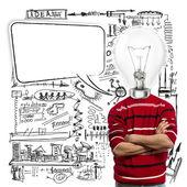 Mężczyzna w czerwonym i główka lampy z dymek — Zdjęcie stockowe