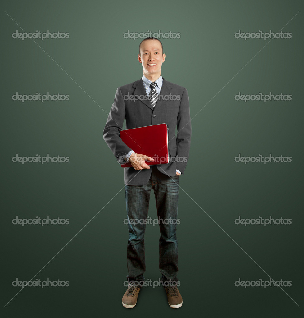 Male businessman in suit with laptop in his hands, looking on camera — Stock Photo #6540702