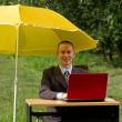 Businessman with umbrella — Stock Photo #6647722
