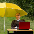 Businessman with umbrella — Stock Photo #6647727