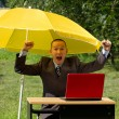 Businessman with umbrella — Stock Photo #6647734