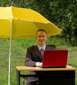 Businessman with umbrella — Stock Photo