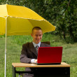 Businessman with umbrella — Stock Photo #6740912