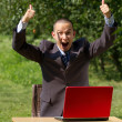 Man with red laptop working outdoors — Foto de Stock