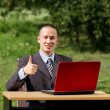 Man with laptop working outdoors — Stock Photo #6741153