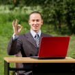 Man with laptop working outdoors — Stock Photo #6741162