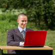 Man with laptop working outdoors — Stock Photo #6741178