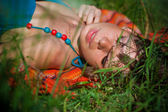 Girl sunbathing on the grass — Stock Photo