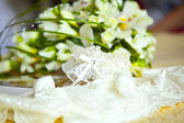 White lingerie and wedding bouquet — Stock Photo