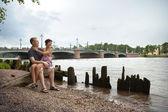 Couple near the river — Stock Photo