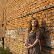 Full length of 9 months pregnant woman stands on street — Stock Photo #6172999