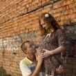 Pregnant girl with a guy — Stock Photo