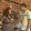 Portrait of a happy young man kisses his pregnant wife . outdoor . — ストック写真
