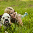 Stock Photo: Girl with a dog on the grass