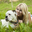 Girl with a dog on the grass — Stock Photo #6181308