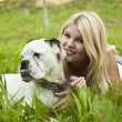 Girl with a dog on the grass - Stock Photo