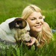 Girl with a dog on the grass — Stock Photo #6211308