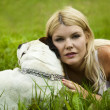 Girl with a dog on the grass — Stock Photo