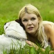 Girl with a dog on the grass — Stock Photo #6211319